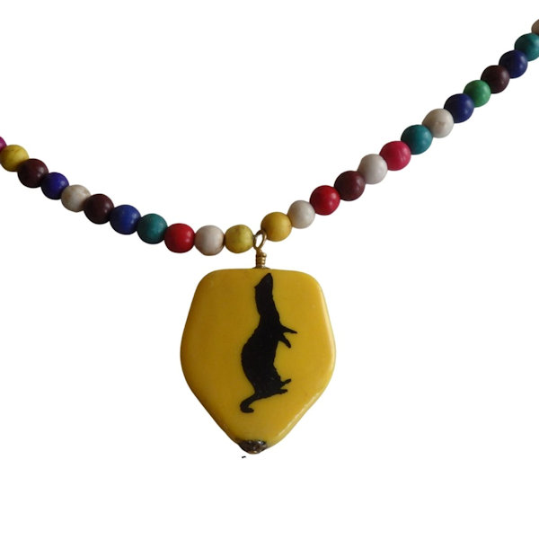 Yellow ferret pendant and beaded necklace 1983